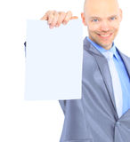 Nice businessman holds white poster Royalty Free Stock Photo