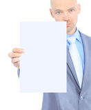 Businessman holds white poster Stock Images