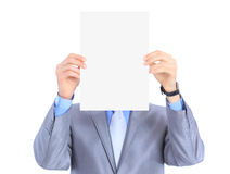 Businessman holds white poster Royalty Free Stock Image