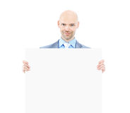 Nice businessman holds white poster. Isolated on white background. Stock Photo