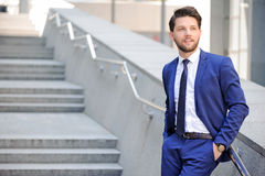 Nice businessman leaning on handrail Stock Photography