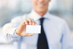Nice businessman standing near office building Royalty Free Stock Image
