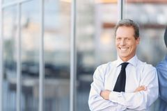 Nice businessman standing near office building Stock Photos