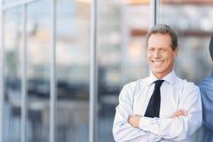 Nice businessman standing near office building Stock Photos