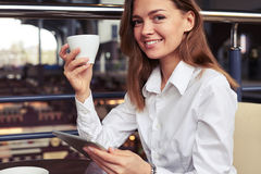Nice businesswoman with cup of coffee Royalty Free Stock Photo