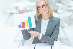 Nice businesswoman holding diagram Royalty Free Stock Image