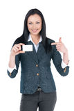 Nice businesswoman showing blank card in her hand. Royalty Free Stock Photos
