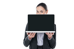 Nice businesswoman showing laptop. Royalty Free Stock Photo