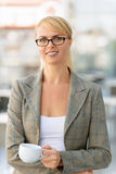 Nice businesswoman standing in the cafe Royalty Free Stock Photos
