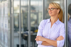Nice businesswoman standing near office building Royalty Free Stock Photography