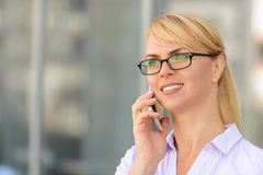 Nice businesswoman standing near office building Royalty Free Stock Images