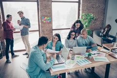 Nice busy attractive serious professional sharks specialists experts wearing casual preparing growth analysis data. Research at industrial loft interior royalty free stock image