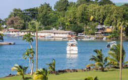 Nice Cabin Cruise Moored in Small Bay Royalty Free Stock Photos