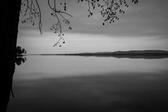Nice calm lake in Québec. Black and white picture. Nice calm lake on a sunset in Québec, near Montreal Royalty Free Stock Image
