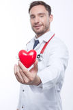 Nice cardiologist holding heart Stock Images