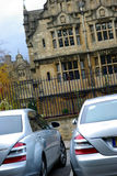 Nice cars in front of a manor Royalty Free Stock Photography