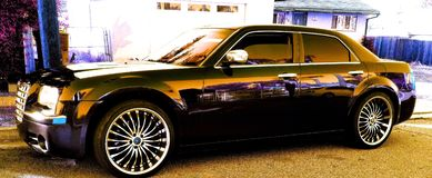 Nice cars. Shiny nice new car 22inch rim Chrysler 300 Hemi transportation vehicle road rim 22 inch style ride open road beauty picture perfect Royalty Free Stock Image