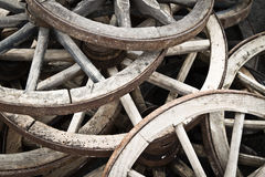 Nice cart wheel background. A lot of horse cart wheel background stock image