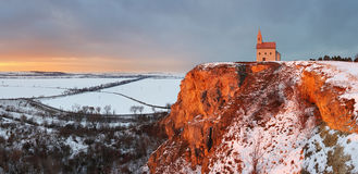 Nice Catholic Chapel in eastern Europe at winter landscape - village Drazovce royalty free stock photos