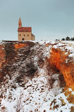 Nice Catholic Chapel in eastern Europe at winter landscape - vil Royalty Free Stock Photography