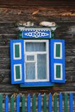 Cats on window of old wooden rural house house royalty free stock images
