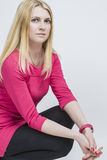 Nice Caucasian Blond Woman In Pink Dress Posing Against White. Stock Photography