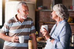 Nice caucasian couple happily chatting at breakfast Stock Image