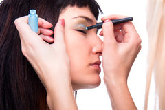 Nice caucasian model applying makeup with brush Stock Images