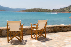 Nice chairs facing the sea Royalty Free Stock Images