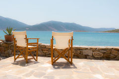 Nice chairs facing the sea Royalty Free Stock Photography