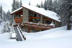 Nice chalet. Luxurious chalet covered with snow in a skiing resort stock photos