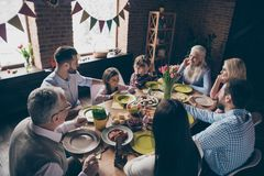 Nice cheerful family small little brother sister sitting having stock photo
