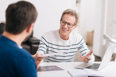 Nice cheerful man holding a document Royalty Free Stock Photo