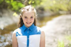 Teen outside in forest. A nice cheerful teen outside in forest Stock Images