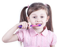 Nice child girl with toothbrush isolated on white Stock Photo