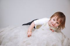 The nice child lying on a light fabric Stock Photo