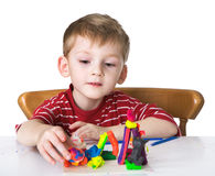 Nice child with plasticine Royalty Free Stock Photo