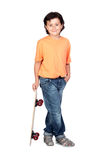 Nice child with wooden skateboard Royalty Free Stock Image