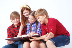 Nice children reading book Stock Images