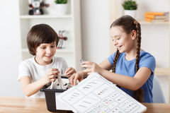 Nice children sitting at the table royalty free stock photography