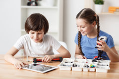 Nice children sitting at the table stock photos