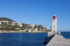 Pier And Lighthouse In Nice. Nice city in France, pier with Phare de Nice lighthouse on Mediterranean Sea stock images