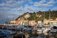 Marina in Nice City at Sunrise. Nice city in France at sunrise, view from Port Lympia on French Riviera to Castle Hill Stock Photos