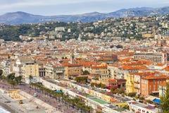 Nice cityscape of old town, sea promenade, hillside villas, mountain range Stock Photos