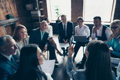 Nice classy stylish sharks sitting on chairs in circle discussing financial plan strategy development corporate. Conference at modern industrial loft interior royalty free stock images