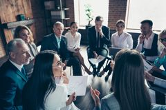 Nice classy stylish trendy cheerful sharks experts ceo boss chief sitting on chairs in circle discussing financial plan. Development at modern industrial loft royalty free stock photos