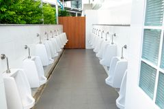 Nice and Clean Men Toilet in the Outdoor Park Building.  royalty free stock image