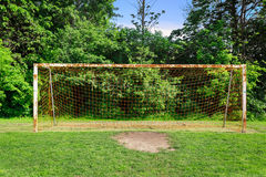 Nice closeup view of  old rusty abandoned goal post standing on field Stock Image