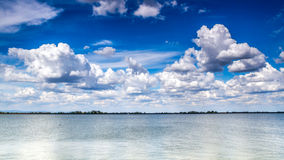 Nice clouds rolling over danube river Royalty Free Stock Photos