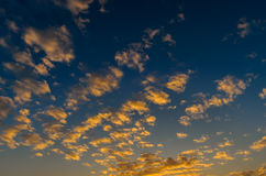 Nice clouds with sunset light Stock Photo